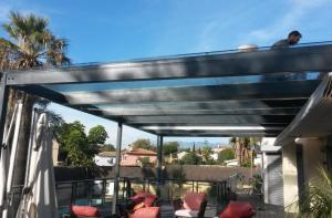 Installation of self cleaning terrace glass roof. Gutter and lightning.
